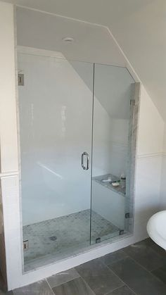 shower with angled ceiling
