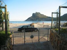 Beach Apartment - Beach Apartment is located right on the beach and offers all the conveniences of Hout Bay, with unique views of Chapman's Peak and the surrounding mountains.  The apartment forms part of a renaissance-style ... #weekendgetaways #houtbay #southafrica