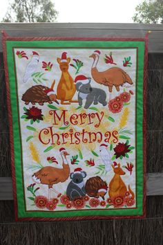 Wish everyone a Merry Christmas fron Down Under with all of my favorite Aussie animals - kangaroos, koalas, cockatoos, emus, and echidnas. This is a printed panel and I have outlined each animal with coordinating thread. Not your typical holiday decoration! It measures 24x44 and comes with two loops to hang with.    *Please note that this item will be custom made so please add an additional week for delivery time.