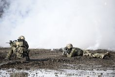 Bundeswehr Infantry practicing extraction of a wounded team member during a mock engagement.
