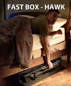 """FAST BOX Hawk. Fast access firearm storage for a long gun up to 46.5"""" in length. Hardware included to attach to metal bed frame for home defense firearms."""