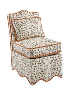 Scallop slipper chair in brown Brunschwig & Fils Les Touches with a signature oomph hit of orange.