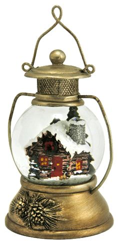 Lantern shape snow globe with  snowy cabin from snowdomes.com