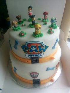 Paw Patrol cake. Two tier vanilla cake with jam and buttercream. Covered with icing and decorated with logo, bones and characters.