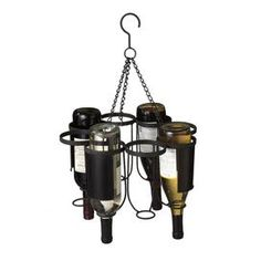"""Showcase your favorite bottles or display the wine pairings for dinner with this beautiful design. Product: Wine holderConstruction Material: MetalColor: BlackFeatures:  Holds eight bottlesChalkboard labels Dimensions: 13.75"""" H x 18.75"""" DiameterNote: Bottles not included"""