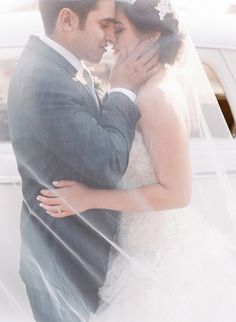 newlyweds behind the veil // photo by Valentina Glidden // http://ruffledblog.com/elegant-orange-county-wedding