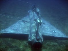 A handout photo June 2011 shows a Greek Air Force Mirage 2000 jet fighter lying in the bottom of the Aegean sea near the Greek island of Samos after it crashed on June Military Jets, Military Aircraft, Fighter Pilot, Fighter Jets, Underwater Ruins, Underwater Shipwreck, Abandoned Ships, Abandoned Property, Hellenic Air Force