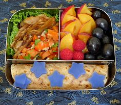 Deconstructed taco bento with fruit and sweet potato stars.