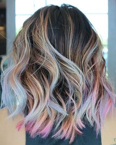 As though colorful beams of light were caressing your hair, this pastel rainbow trend will add plenty of glam to your summer look. hair Pastel Rainbow Highlights For Summer Peekaboo Hair Colors, Hair Color Purple, Hair Dye Colors, Cool Hair Color, Pastel Hair Colors, Light Hair Colors, Pastel Ombre Hair, Colorful Hair, Summer Hairstyles