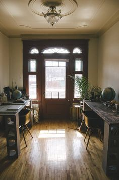 Love the period door & sidelights, ceiling etc from Isaac and Florence's Eclectic Zen-Inspired Apartment