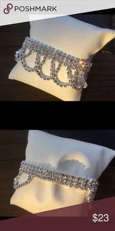"Crystal Draped Bracelet Crystal Lined Draped bracelet. Approx 2.2"" in diameter. Stretch Band. Lead / Nickel Compliant. Jewelry Bracelets"