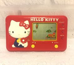 School Bus Hello Kitty Sanrio Tomy LCD Handheld Game. Light wear. Batteries not included. No original box or instructions. | eBay!