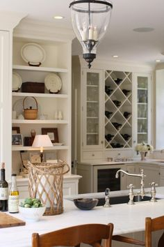 J K Kling associates - I like the wine rack, cabinets for your wine glasses and wine refrigerater all in one section of your kitchen