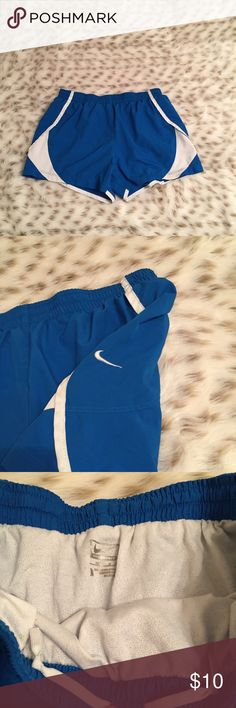 Nike Performance Running Shorts Nike performance running shorts! Size medium. So cute! Used but in great condition. Has small stain on left leg area. Could probably be bleached out but I don't want to accidentally mess them up 😿 Nike Shorts