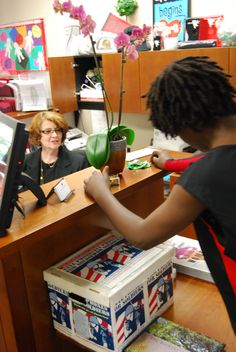 Ms. Holtzman helping a student—of course!
