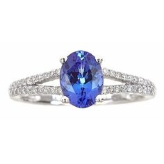 A beautiful tanzanite gemstone is prong-set atop this beautiful ring. Crafted of 14k white gold, this ring features diamonds along the split shank band. Gemstone colors: Blue Gemstone shapes: Oval One
