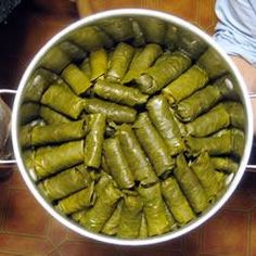 These stuffed grape leaves are filled with ground lamb, fresh mint, and pine nuts. Enjoy them as a main dish or as a meze (appetizer). Grape Leaves Recipe, Stuffed Grape Leaves, Ground Lamb, Mediterranean Dishes, Arabic Food, Fresh Lemon Juice, Stuffed Peppers, Ethnic Recipes, African Recipes