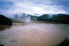 Lake Nyos Outgassing - The 50 Most Famous Disaster Photographs | ComplexCasualties: 1,700  The deadly cloud of carbon dioxide that came over Cameroon in 1986 was undetectable until people and livestock began to fall dead around Lake Nyos. The lake sits atop a dormant volcano and emitted gasses built up over hundreds of years. The lake's once-blue water turned muddy red.