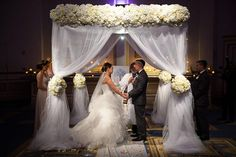 Wedding ceremony with floral huppah at The Grove.