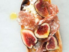 Salami and Fig Crostini with Ricotta - Figs and salami are assertive ingredients to pair together on a little crostini, yet the result is subtle, delicate and delicious. http://www.foodandwine.com/recipes/salami-and-fig-crostini-with-ricotta