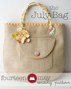 burlap bag with a fabric strap handle braided. and love the flower embellishment. could be done with coordinating fabric. this pattern looks simple.