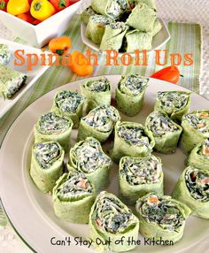 Spinach Roll Ups-  These delicious Spinach Roll Ups have a tasty cream cheese base with Ranch dressing mix, bacon, orange bell pepper, green onions, and spinach, and they are awesome.