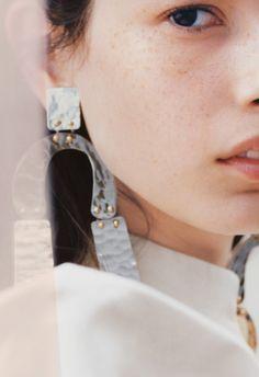 Proenza Schouler earrings; Dries Van Noten blazer.
