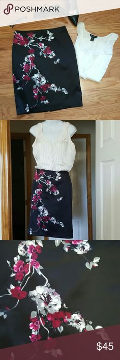 "WHBM Floral Pencil Skirt Elegant, beautiful Silky Pencil Skirt by White House Black Market. Sturdy construction with a hidden back zipper, small slit in center hem, and a full lining. Jet black with a gorgeous Floral design in white, Gray, and a beautiful dark fuchsia for a subtle pop of color. Pairs perfectly with the white silk WHBM blouse also for sale in my closet. Flawless condition. Size 2. Measurements lying flat waist 14.5"", length 22"" White House Black Market Skirts Pencil"