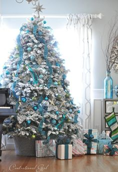 A white frosted tree has tons of combination possibilities           —  try mixing in pops of blue for an icy effect.  See more at Centsational Girl »    - HouseBeautiful.com
