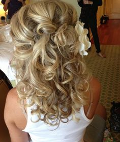 A less structured curly wedding hair style.