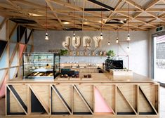 the bar signage from CNC plywood is backlit with LED lights design studio jury cafe melbourne australia Raw materials cafe Design Studio, Bar Design, Coffee Shop Design, Store Design, Counter Design, Cafe Bar, Cafe Restaurant, Restaurant Design, Colorful Restaurant