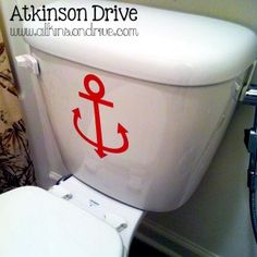 Maybe not the anchor, but I like the idea of a vinyl sticker on the commode.
