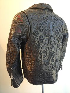 Logan Riese Leather jacket with skulls and cross by ~loganriese on deviantART. This is one of the most incredible leather-work pieces I think I've ever seen. WOW.
