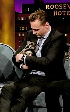 #TomHiddleston and baby animal, too cute!