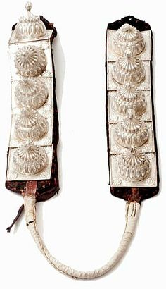 Elephant jewellery (dumachi), Udaipur, 1800-1910, silver, white metal, cotton, leather. As the mount of a king, a royal elephant was equally richly dressed. Elephant jewellery included a dumachi or tale ornament. This example belongs to the royal family of Mewar and is still used occasionally.