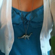 Dollar store dinosaur toy covered in glitter nail polish on a chain. Awesome!
