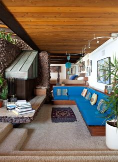 sunk living room with blue cushions