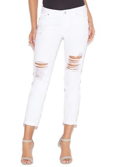 Memorial holiday isn't the only day to wear white. Perfect your street style game with the Distressed Slim Boyfriend jean. A chic and simple white denim with a detailed thigh high cut out.