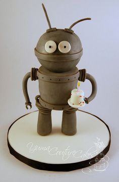 Robot Cake.    A robot made of cake that looks like he is giving you a cake, how freaking adorable is that. I couldn't eat something as cute as the robot, but I'm glad he comes with a little cake. I'd eat the little cake!