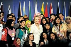 U.S. Secretary of State Hillary Clinton, poses for a photo with attendees of the Women in Public Service Project, held at Wellesley College, June 11, 2012.