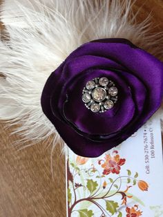 Find me on Facebook. Corryn's Pretty Little Things. I made this. Purple feather, hair clip. DIY.