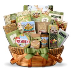 "Gourmet Elegance  A large Willow Basket  is filled with Three Pepper Blend Water Crackers (8oz), Almond Roca Buttercrunch Toffee Cookies (3oz), Barnier Herb Marinated Olives (4.4oz), A 4-pack of Tazo ""Zen"" Tea (.16oz), Jack Allen Bruschetta Mix (2oz), Brent & Sams White Chocolate Macadamia Cookies (2oz), Jack Allen Chocolate Covered Truffle Cookies (1.8oz), Jack Allen Fruit & Nut Mix (1.5oz), Napa Valley Whole Grain Mustard (1.75oz), and more  $119.99"