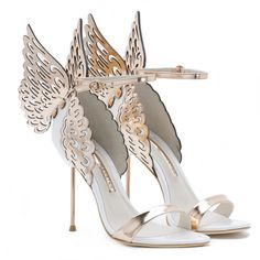 EVANGELINE £395.00  White leather angel wing sandal with rose gold metallic wings, straps, buckle and heel. 100mm heel.