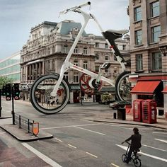 Odd, out of scale. #Strida , huge triangle of a folding bike takes to the streets