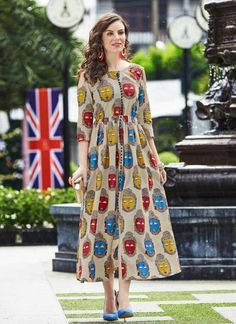Get a dose of freshness with this multicolor tunic, printed all over in lawn cotton. With a front slit and yoke detailings, the design is a perfect pick. Kurta Designs Women, Kurti Neck Designs, Salwar Designs, Blouse Designs, Kalamkari Dresses, Ikkat Dresses, Kalamkari Designs, Indian Fashion, Style Fashion