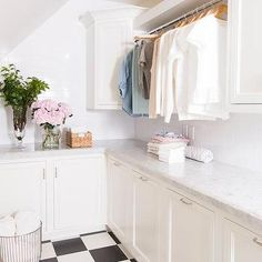White Laundry Room with Black and White Checkered Floor Tiles