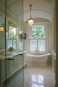 Kate Coughlin Interiors: Stunning long and narrow master bathroom with barrel ceiling and crystal chandelier over ...