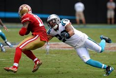 Carolina Panthers safety Kurt Coleman, right, reaches out to make the tackle on…