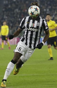 Juventus' Paul Pogba runs towards the ball during the Champions League round of 16 first leg soccer match between Juventus and Borussia Dortmund at the Juventus stadium in Turin, Italy, Tuesday, Feb. 24, 2015.
