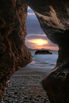 Sunset through natural rocks by Dimitris Koskinas on 500px